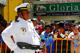 Members of the public watch the military parades for Dia del Mar / Day of the Sea, Plaza Avaroa, La Paz , Bolivia