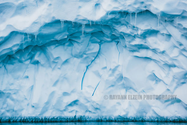 Stalactites and details of the ice on the wall of an iceberg in Ilulissat