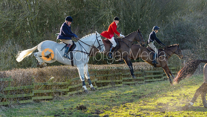 Charlie Gordon-Watson jumping a hedge at Town Park Farm - The Cottesmore at Town Park Farm
