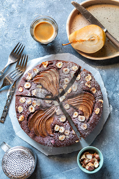 Chocolate cake with pears and hazelnuts on the table