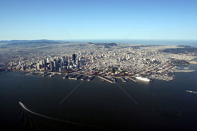 "Aerial view from San Francisco Bay to the Pacific Ocean, with a ferry heading towards the Ferry Building, and cruise ship ""Ca..."