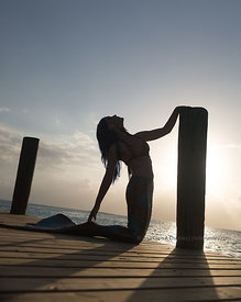 Mermaid Iara Mandyn on dock in late afternoon, Nassau, Bahamas Islands