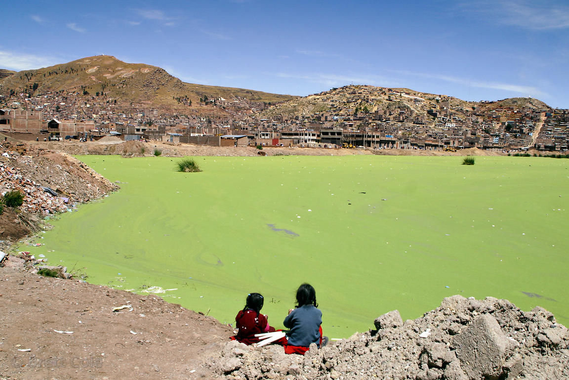 Children play at the banks of Lake Titicaca in Puno, Peru. Pollution from this rapidly growing city has fouled the shores, gi...