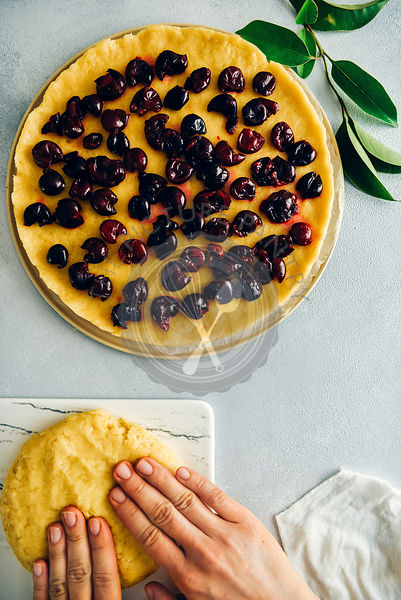 Pie dough topped with cherries