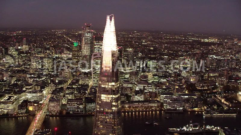 Night aerial footage of the Shard and City of London.