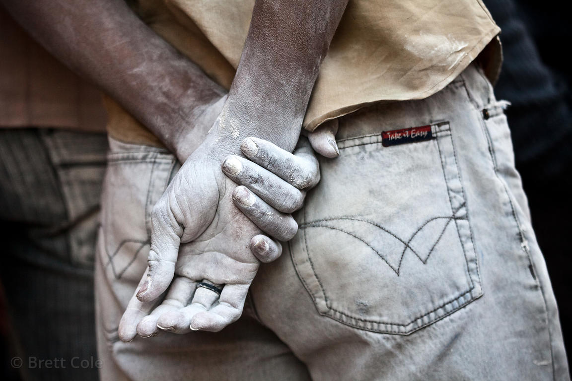 Hands of a construction worker white with concrete dust, Jodhpur, Rajasthan, India
