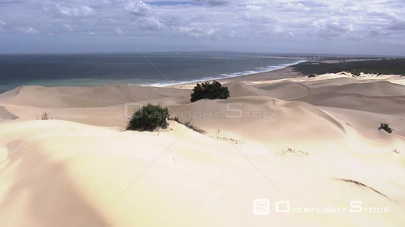 Sand dunes and ocean on the Eastern Cape coastline South Africa