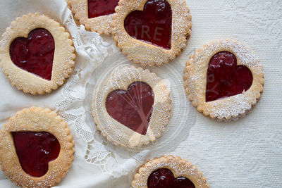 Strawberry Jam, heart shaped Linzer Biscuits on Lace