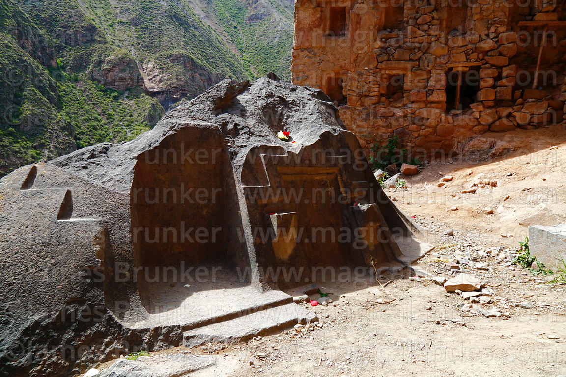 Carved bluestone altar in entrance to cave at Ñaupa Iglesia shrine / huaca, Huaracondo Valley, Cusco Region, Peru