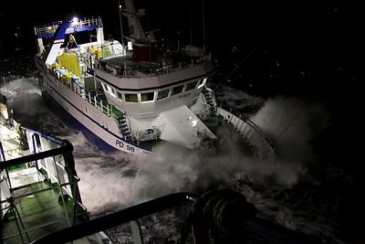 Fishing vessel 'Harvester' manoeuvring in stormy conditions on the North Sea, Europe, January 2012. Property released.