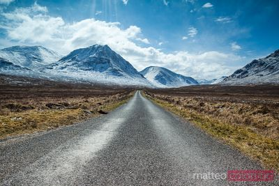 Road to snow covered mountains, Highlands, Scotland