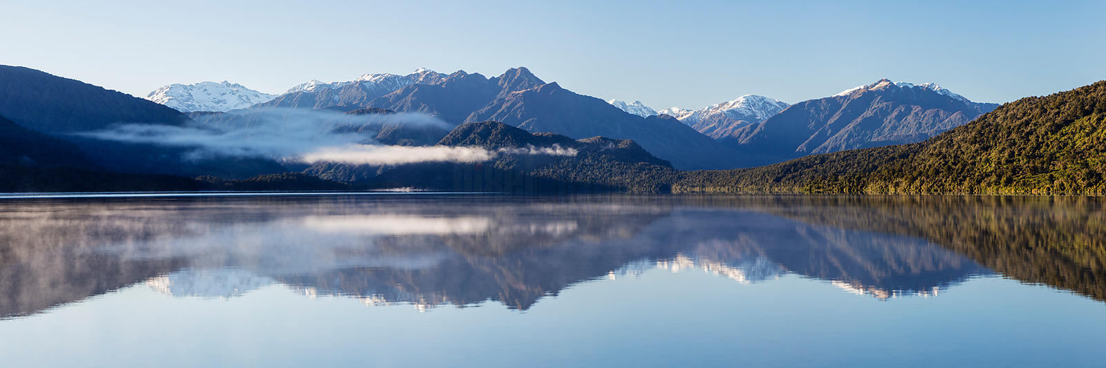 Reflections on Lake Kaniere after Sunrise