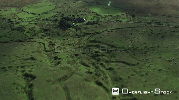 Aerial view tracking over Whiteworks hamlet, showing evidence of past mining, Dartmoor National Park, Devon, England, UK, Oct...