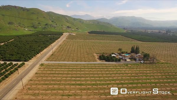 Farm Lands Flower Fields and Ranch Bakersfields California Wide Aerial Moving Forward Evening Sunset