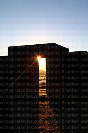 Sun shining through main entrance to Kalasasaya temple soon after sunrise on June 21st solstice, Tiwanaku, Bolivia