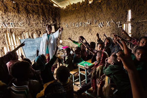 Children in an English Class in a Community School