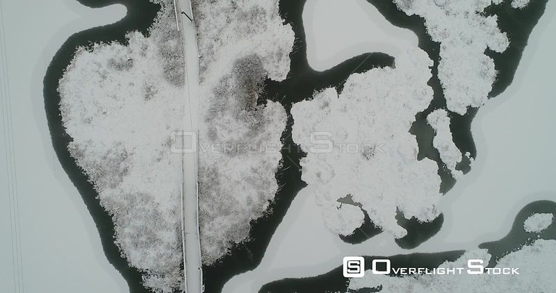Aerial shot of lake covered by the first snow, Bindingsvann, Akershus, November Norway, November 2017.
