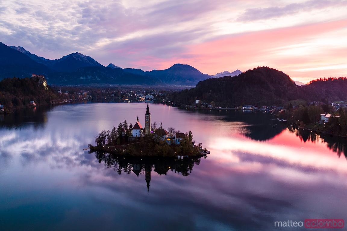 Aerial of Bled lake and island at sunrise, Slovenia
