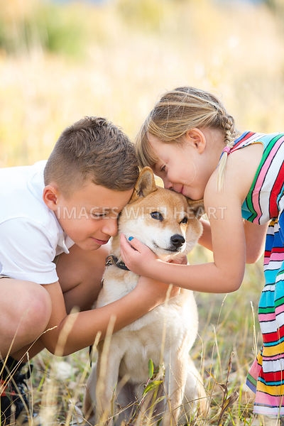 Small Dog With Two Children Outdoors
