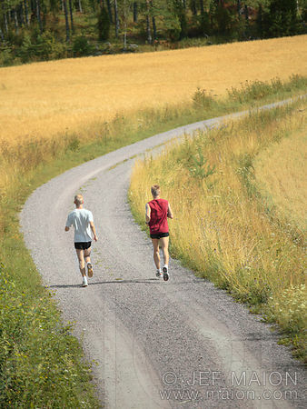 Running on trail by wheat field