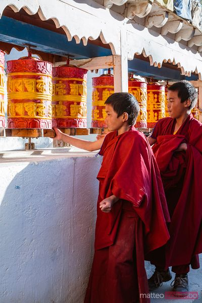 Monks spinning prayer wheels, Upper Mustang, Nepal