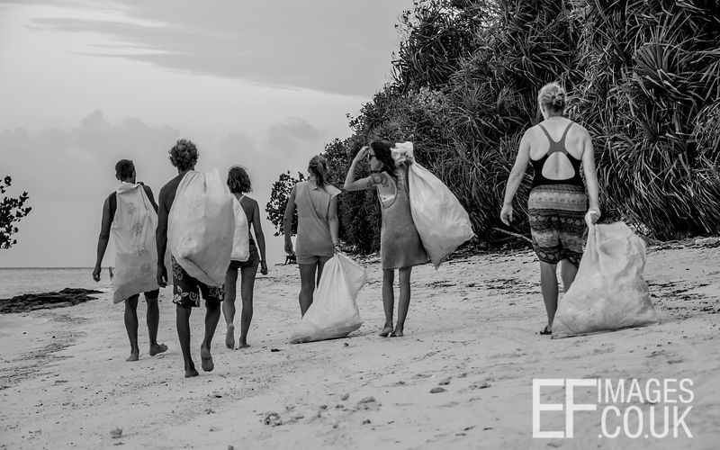 Wednesday evening trash collection time. This group of people take a boat round to various of Pom Pom Island's beaches every Wednesday evening and pick up as much plastic as they can carry. They take it all back to camp, sort it and ship it to the mainland to be recycled.