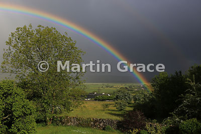 Double rainbow over sunlit Lyth Valley in early June, Cumbria, England