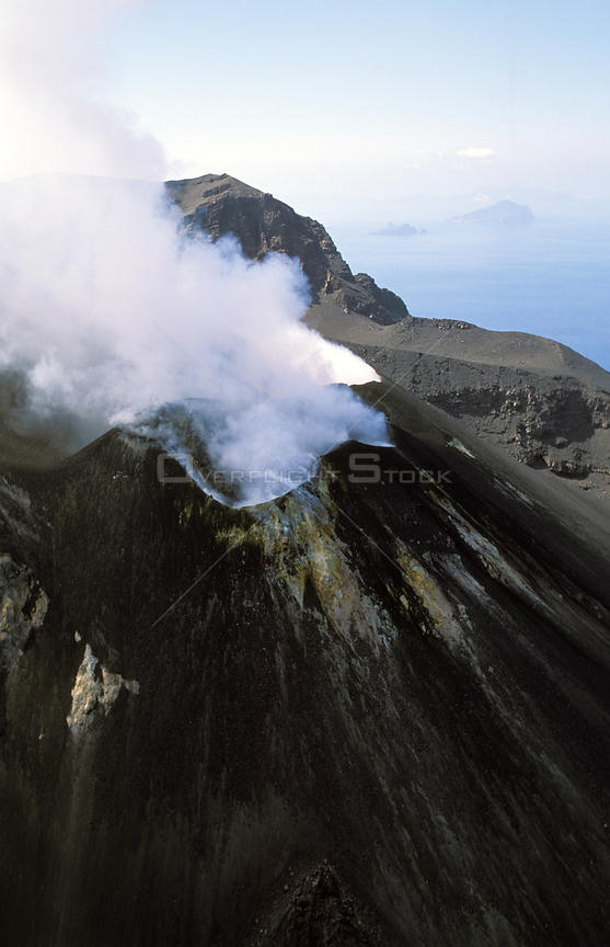 Smoking crater on the volcanic island of Stromboli, Aeolian Islands, north of Sicily. Stromboli is a very active volcano.