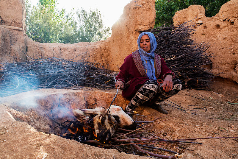 Berber Woman Cooking Goat Heads on Open Fire