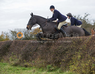 Debbie Barnes jumping a big Cottesmore hedge
