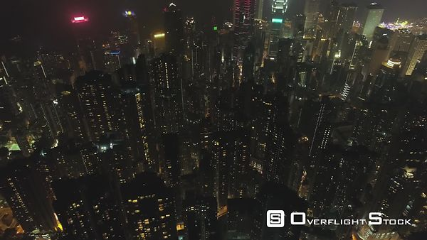 Hong Kong Residential Tall Buildings at Night. Aerial Vertical TopDown View. Drone is Flying Forward. Establishing Shot.