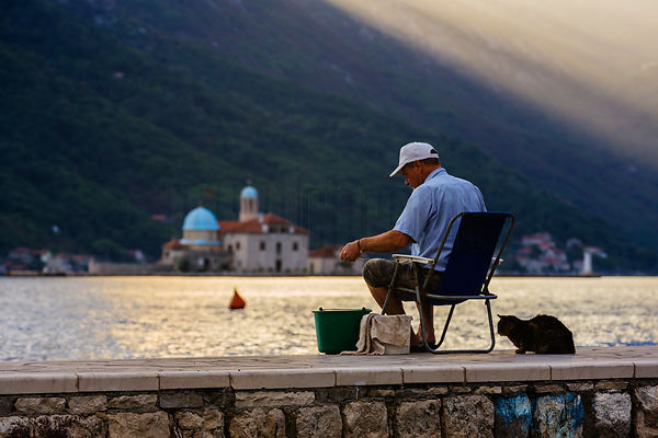 Fisherman on Adriatic Inlet at Perast