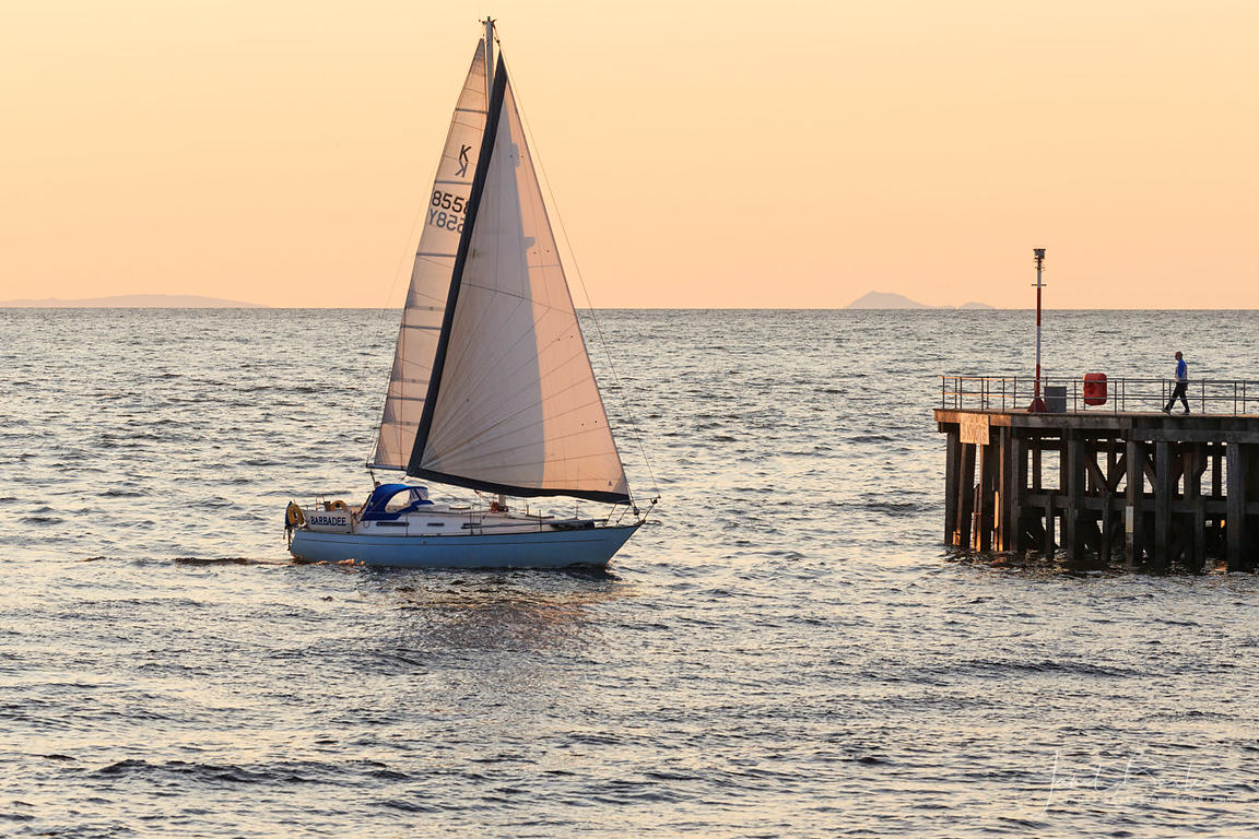 Yacht at sunset, Aberystwyth harbour