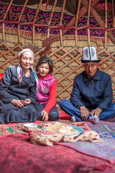 Kyrgyz family inside a yurt, Xinjiang, China