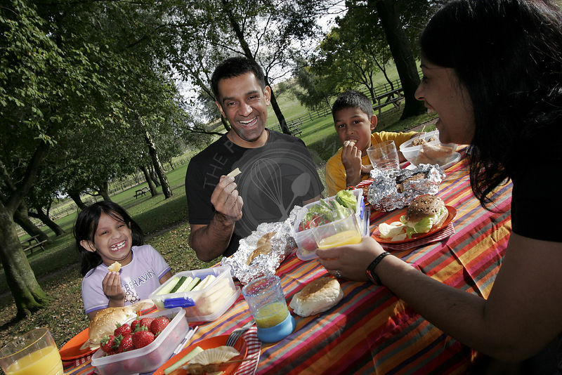 Asian family having a picnic in the countryside