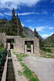 Inca wall, doorways and water channel at Ollantaytambo, Sacred Valley, Peru