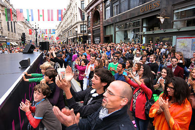 Crowd applauding performers in Regent Street, London