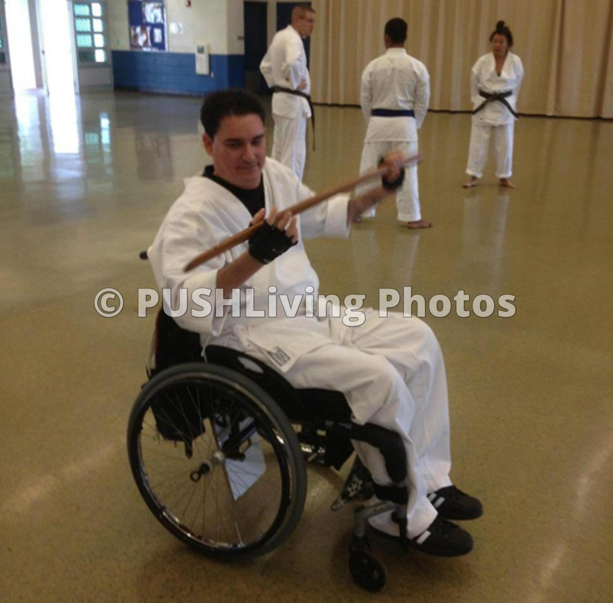 PUSHLiving Disability Stock Images Karate Bokken demo - wooden sword