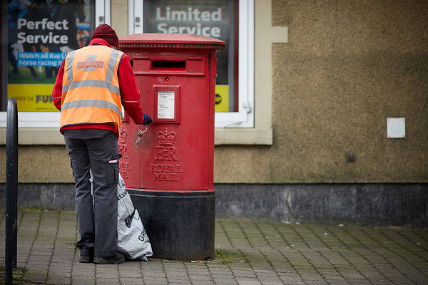 Royal Mail postbox and worker