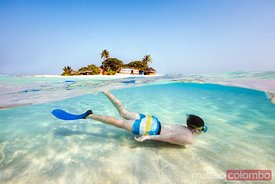 Split image of boy snorkeling underwater, Maldives