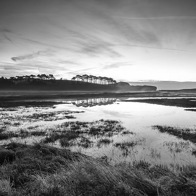 Winter twilight clouds, rising mist and perfect reflections on the River Otter at Budliegh Salterton, Devon, UK