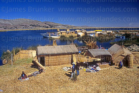 Tourists visiting the Uros floating reed islands, Lake Titicaca, Peru