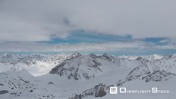 Aerial shot of snowcaped peaks of Alps over Pitztal glacier in Tyrol, Austria