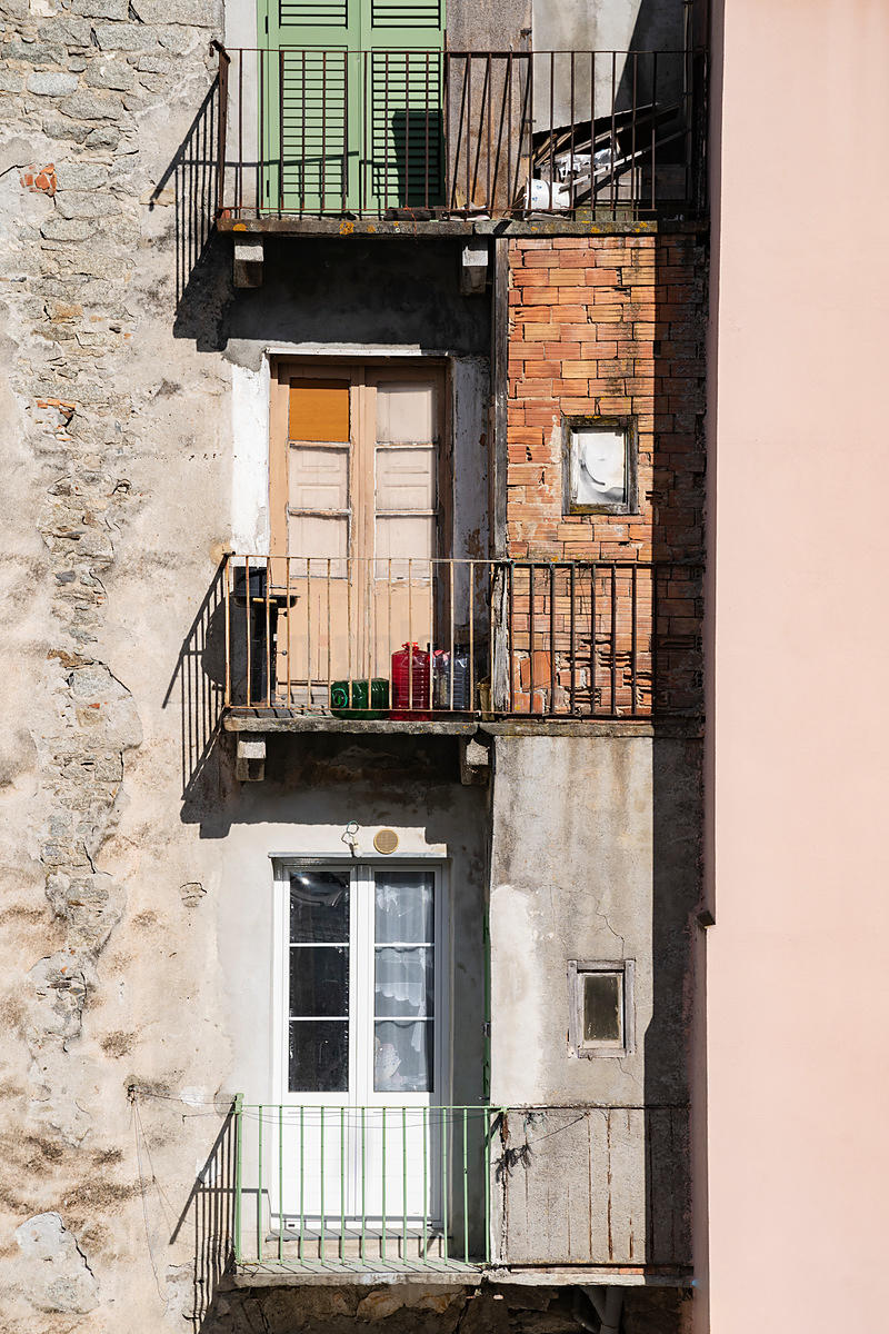 Balconies of Houses in the Old Town of Corte