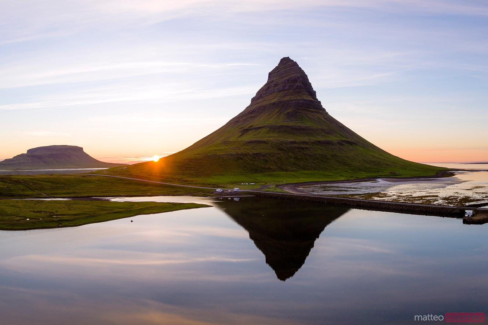 Aerial drone view of mount Kirkjufell reflected at sunset, Iceland
