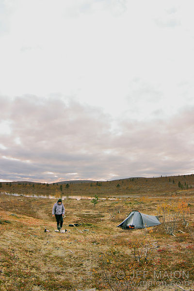 Camp on tundra by desert lake