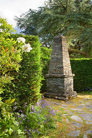Stone obelisk by Joe Smith in Sunken Garden