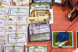 Miniature degree certificates for sale on market stall, Alasitas festival, La Paz, Bolivia