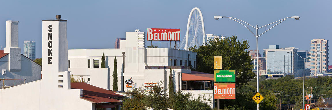 The Belmont Hotel and Smoke with the Margaret Hunt Bridge in the Background