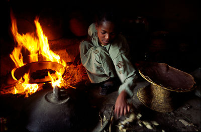 A Ethiopian child cooking in her home
